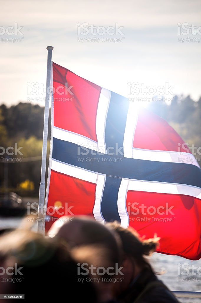 Norwegian national flag close up on a ship stock photo