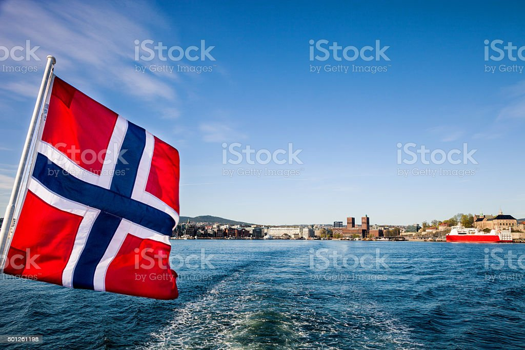 Norwegian national flag in front of Oslo stock photo