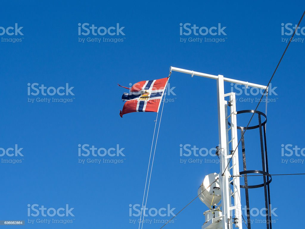 Norwegian Post Flag on Ferry flagpole against blue sky stock photo