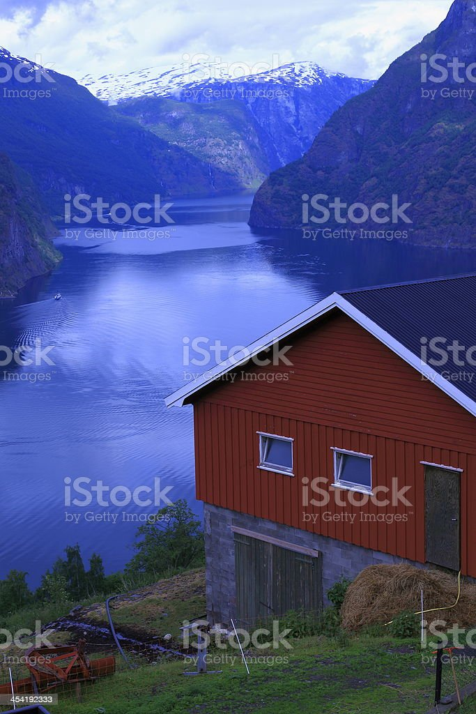 Norwegian red house above Aurland fjord, Norway, Scandinavia stock photo