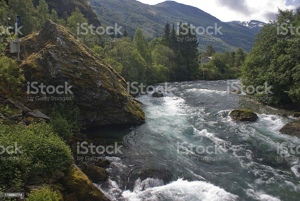 Norwegian river rushing through rocks stock photo