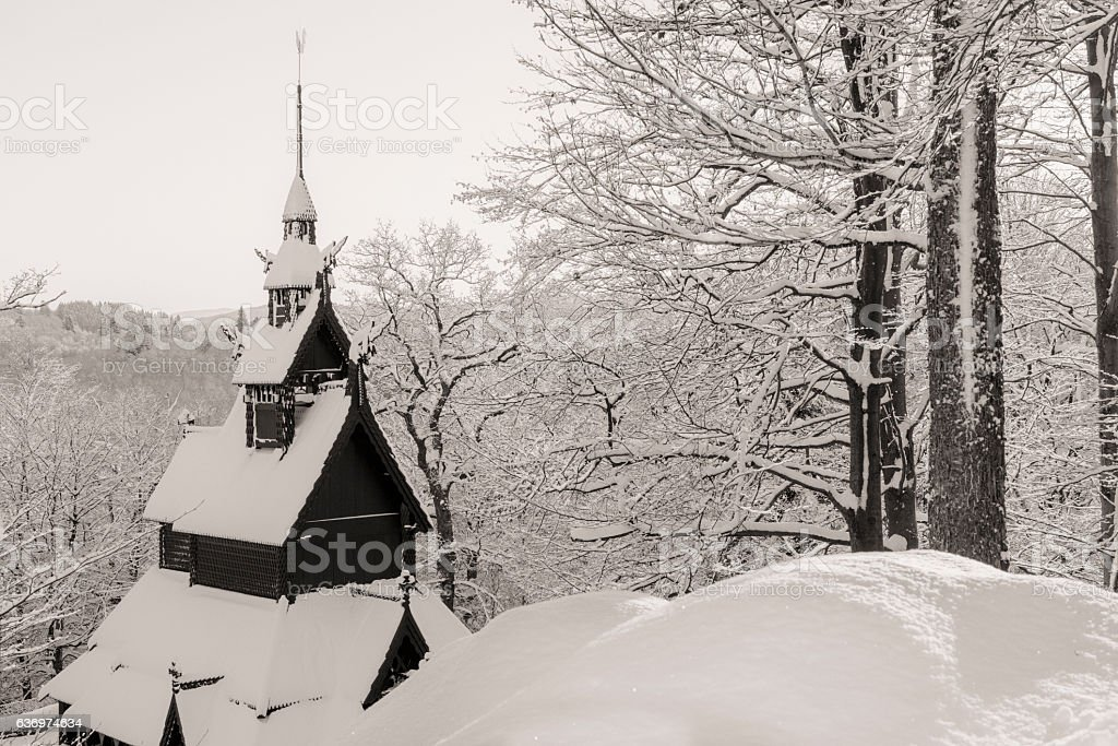 Norwegian Stave Church in winter landscape stock photo