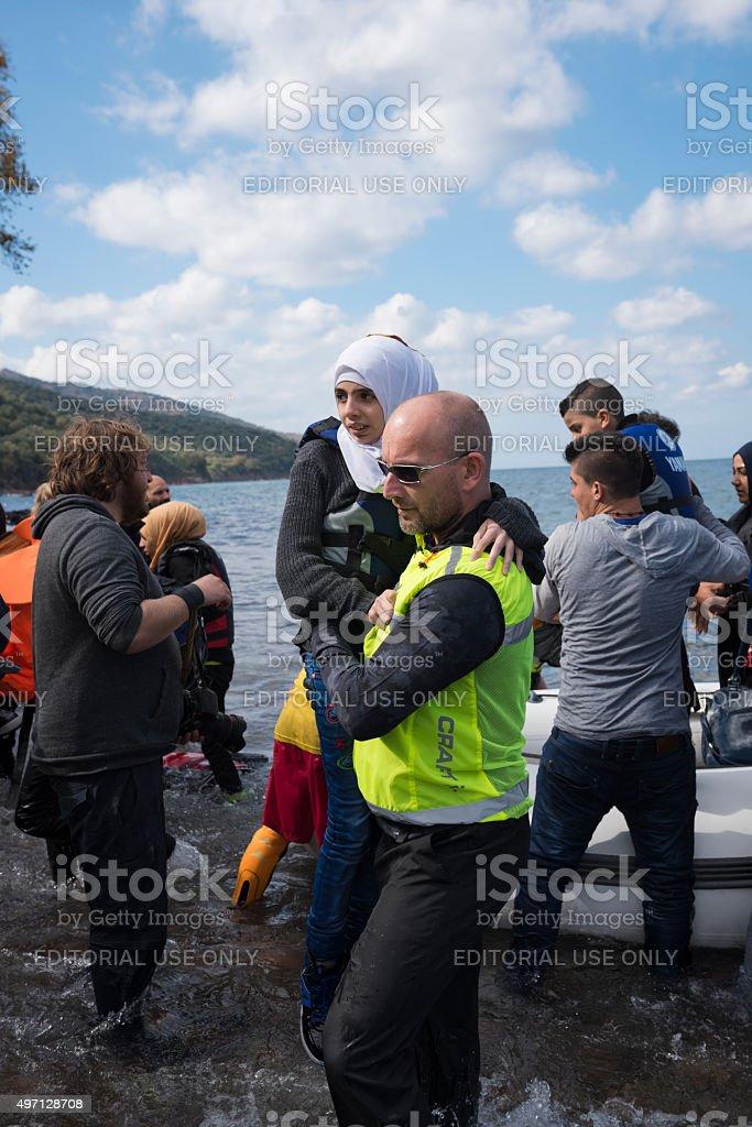 Norwegian volunteer assisting arriving refugees on Lesbos stock photo