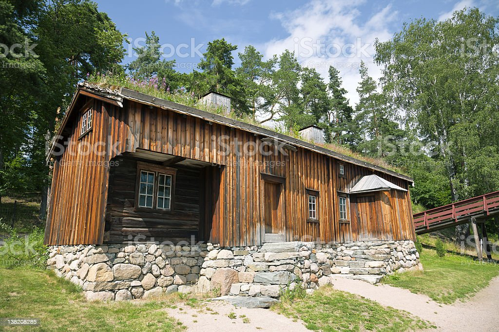 Norwegian Wooden House in the Forest royalty-free stock photo