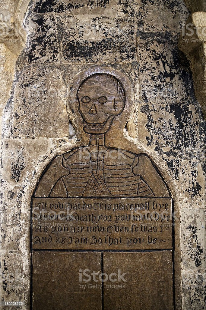 Norwich Cathedral - skeleton on plaque giving a warning stock photo