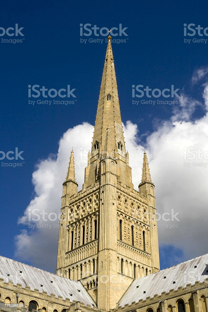 Norwich Cathedral spire with background clouds royalty-free stock photo
