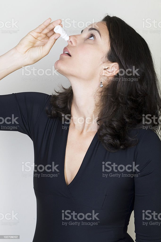 nose drops woman stock photo