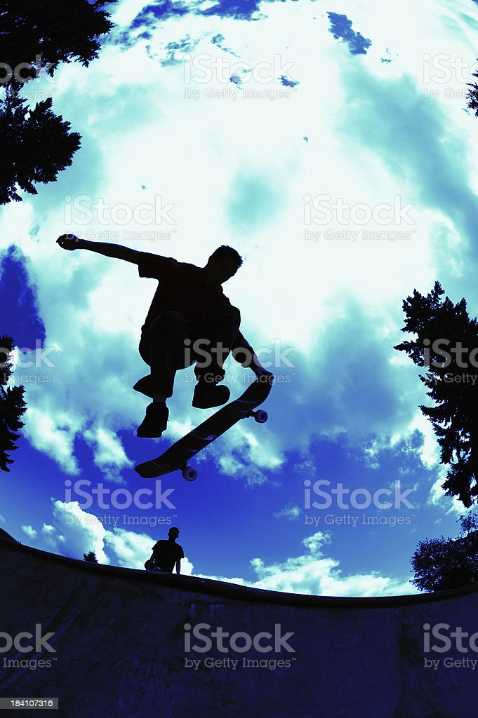 Nose Grab - Blue Sky Silhouette royalty-free stock photo