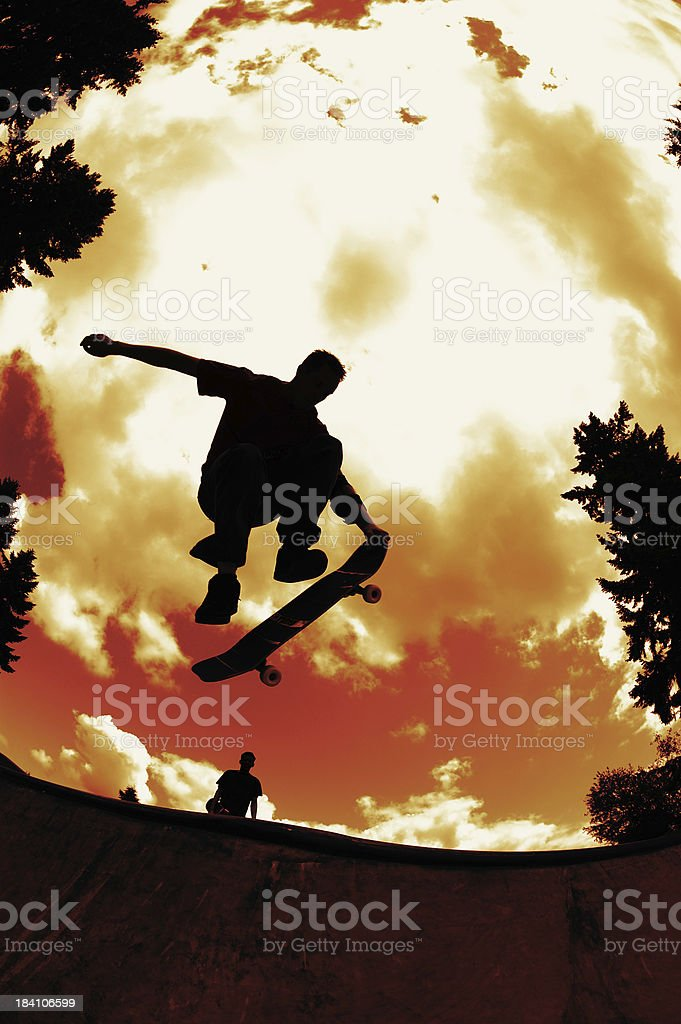 Nose Grab - Red Sky Silhouette royalty-free stock photo