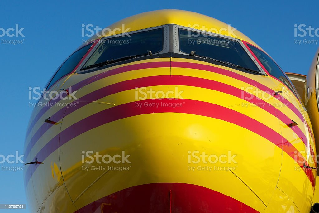 Nose of yellow and red aircraft royalty-free stock photo