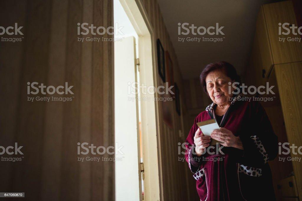 Nostalgic grandma fondle picture stock photo