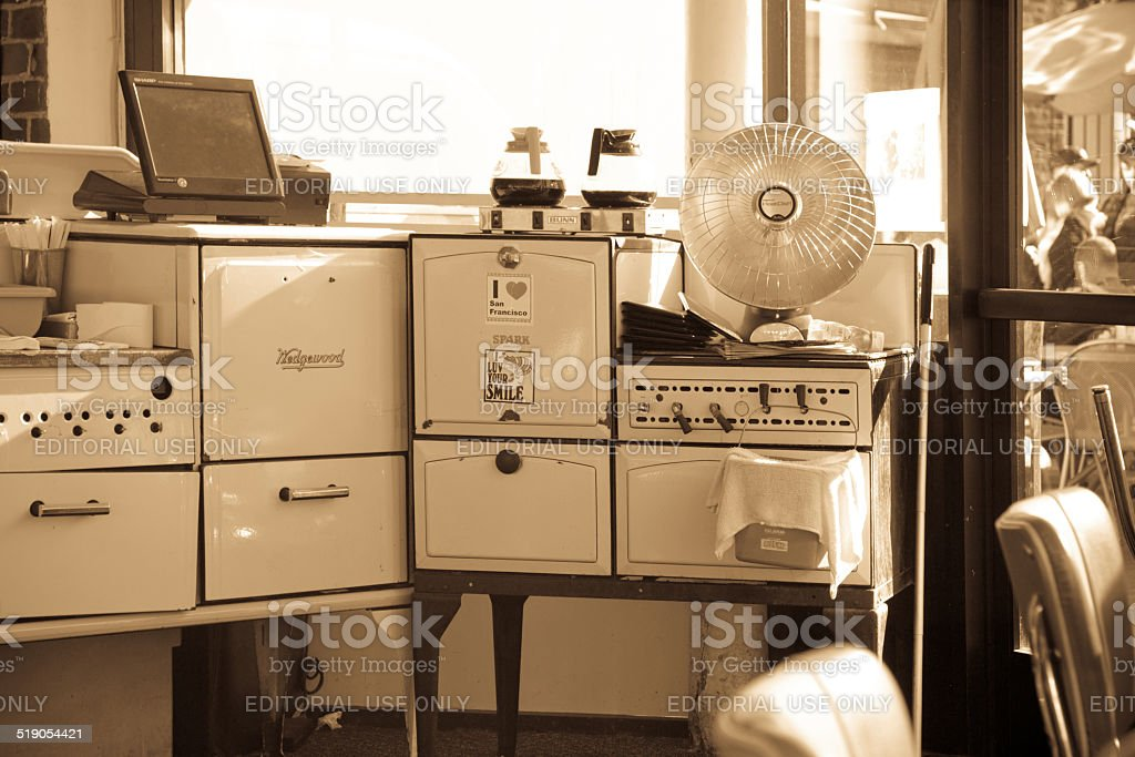 Sepia toned image of 1950s kitchen equipment in a shop window in San...