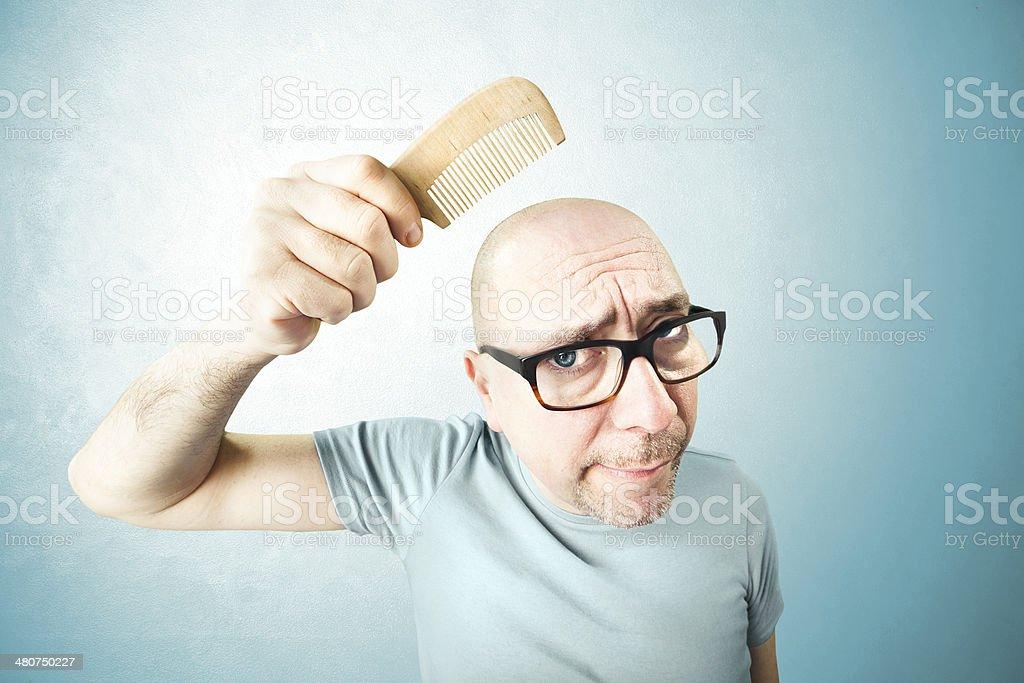 nostalgic man comb his bald head stock photo
