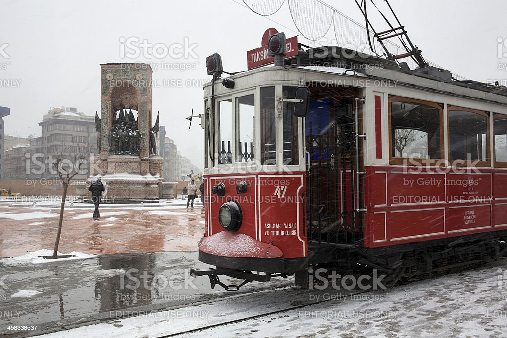 Nostalgic Tram and Taksim Monument of Republic at Snowy Day stock photo