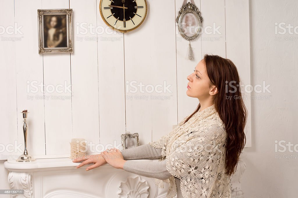 Nostalgic woman looking at an old family portrait royalty-free stock photo