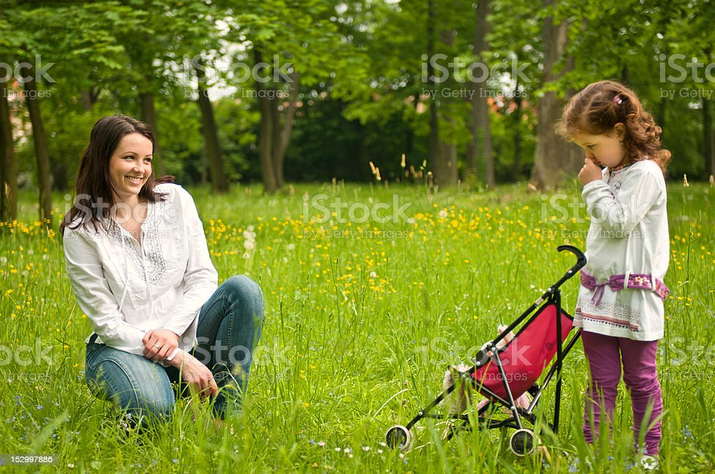Nostalgy - mother with her child outdoors royalty-free stock photo