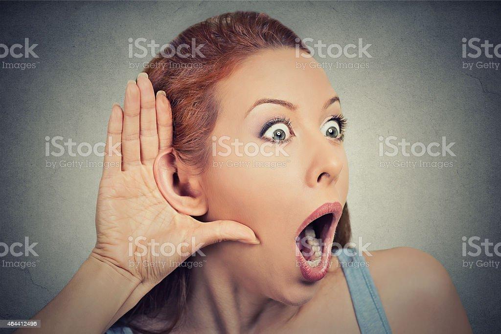 nosy shocked woman listening eavesdropping stock photo