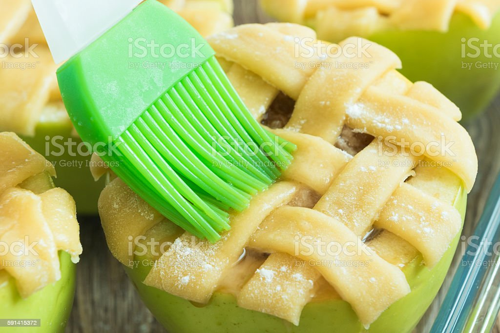 Not baked apples with brush and egg stock photo