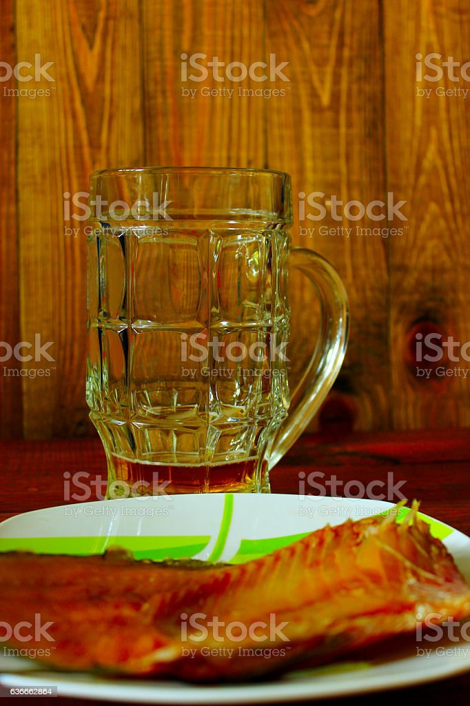 not drunk up glass of beer and sea-roach stock photo