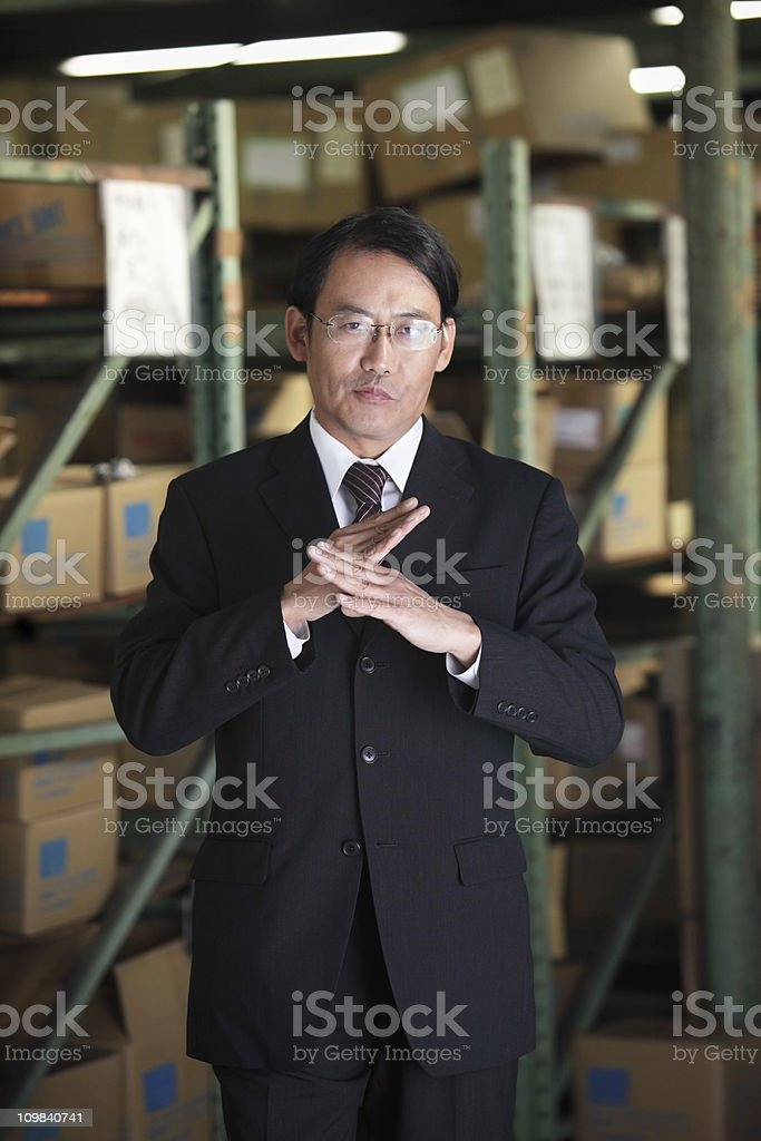 Not Exist or Possible, Japanese businessman in warehouse royalty-free stock photo