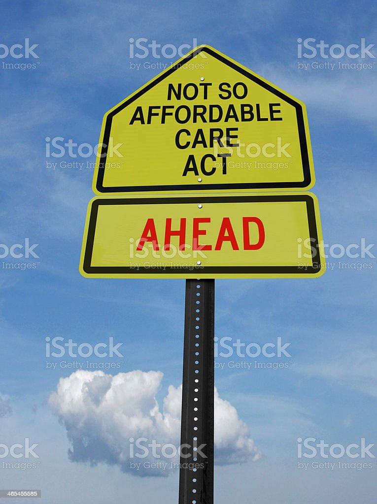 not so affordable care act ahead sign stock photo