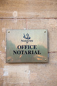 Notaire ofice notarial Notary office sign seen from street