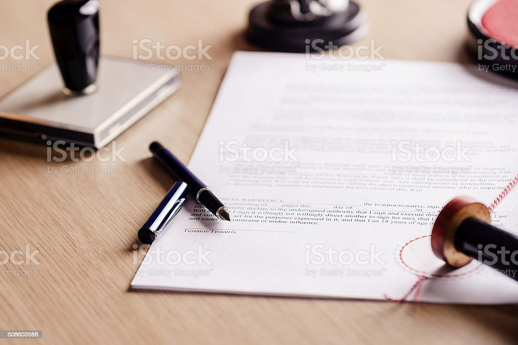 Notary pen lying on testament. stock photo