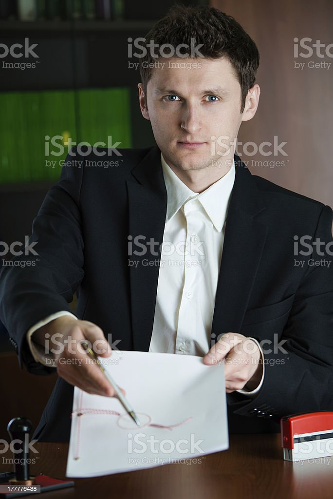 Notary public showing where to sign.to royalty-free stock photo