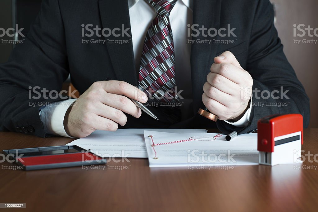 Notary public stamping a document royalty-free stock photo
