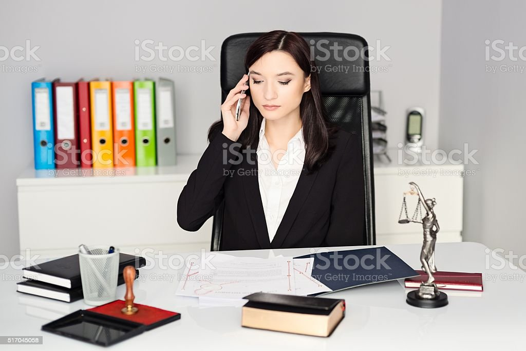 Notary Public talking on cellphone in her office stock photo