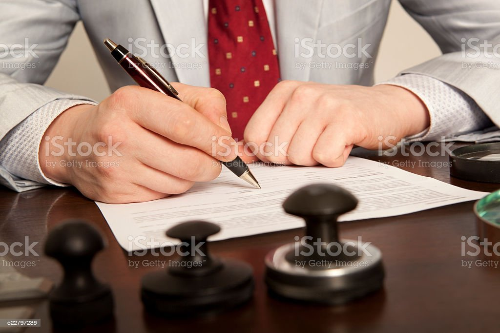 Notary signs the documents from our office stock photo