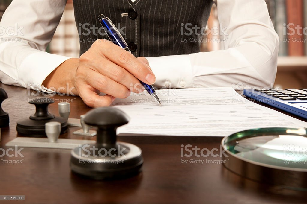 Notary signs the documents in office stock photo