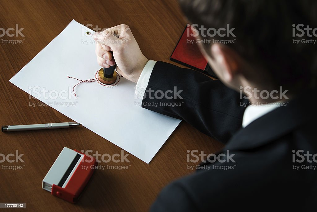 Notary stamping document royalty-free stock photo