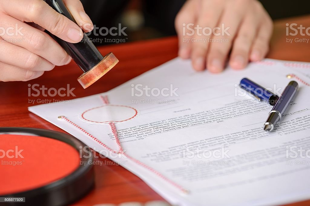 Notary stamps signed contract stock photo