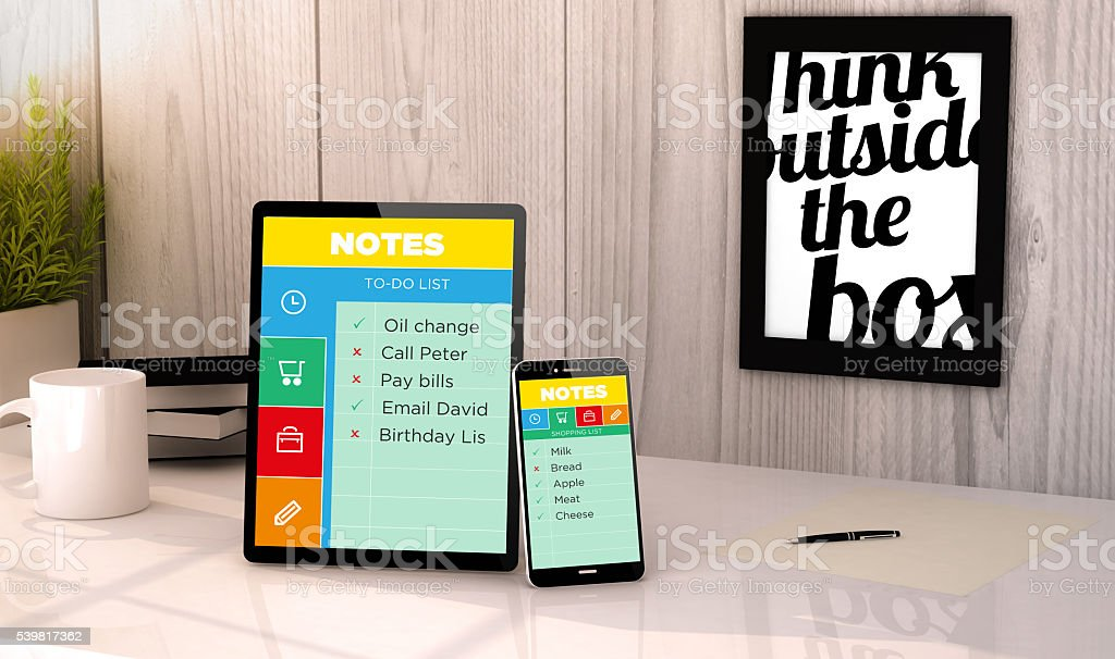 Note application on devices on a workplace mockup stock photo