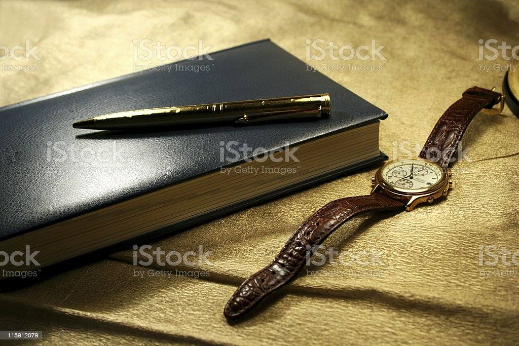 Note book, pen and hand watch royalty-free stock photo