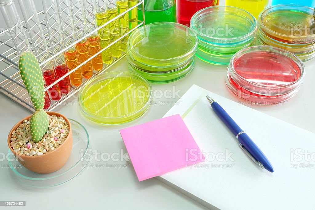 note book with colorful fluid in glassware stock photo