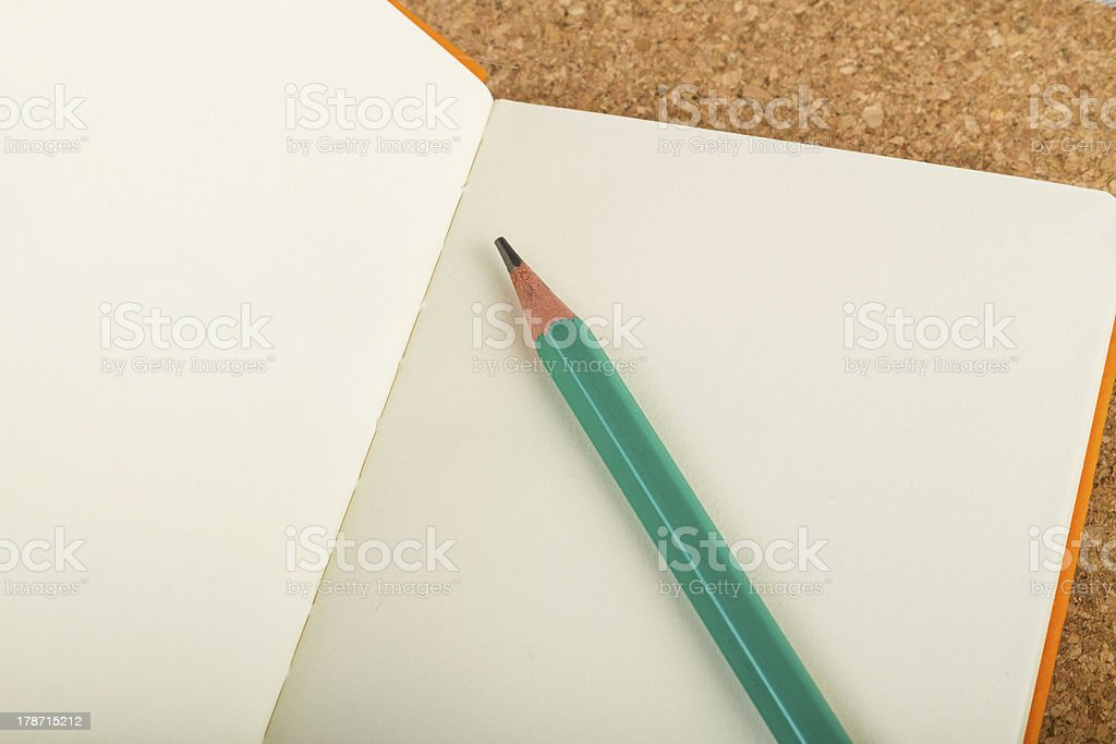 Note book with pen royalty-free stock photo