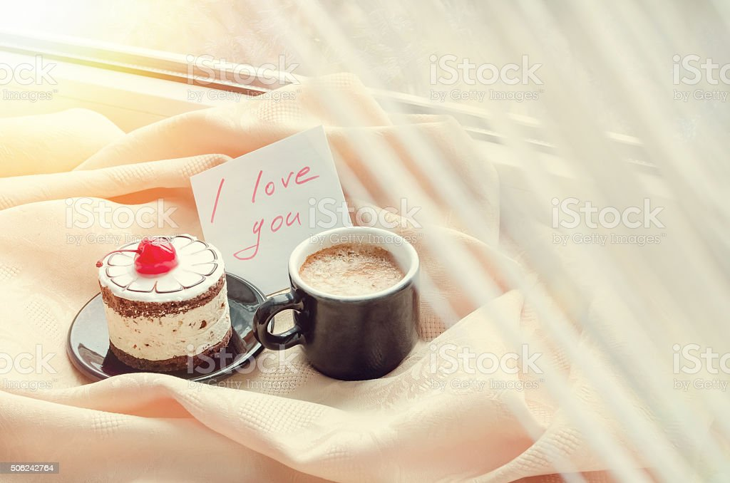 Note I love you with cup of coffee and cake stock photo