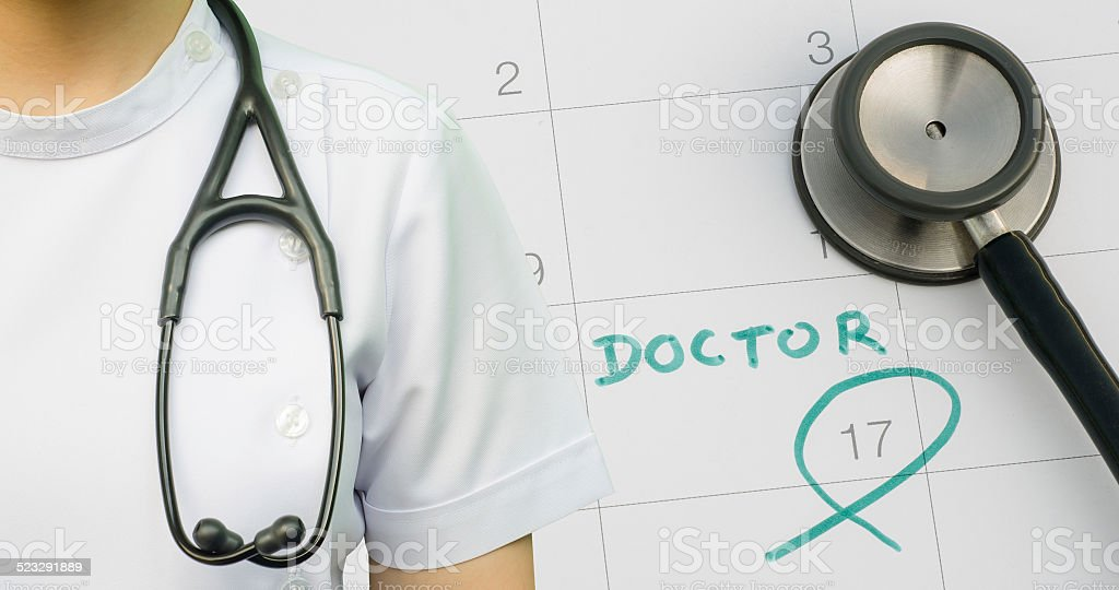 Note of doctor appointment on calendar stock photo