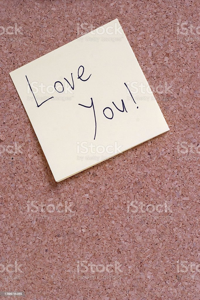 LOVE YOU note on a bulletin board royalty-free stock photo