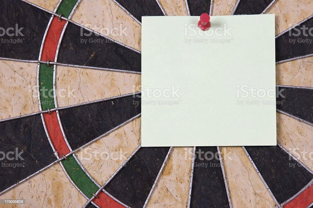 Note on Dartboard. royalty-free stock photo