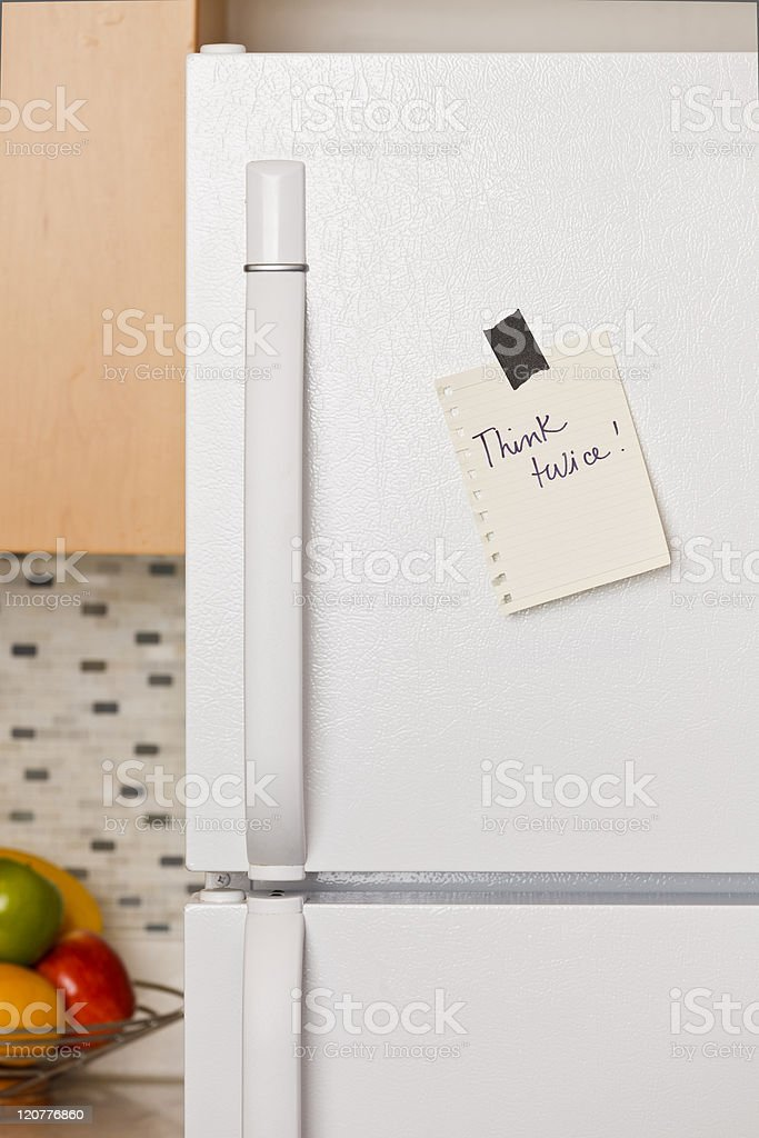 Note on refrigerator door royalty-free stock photo