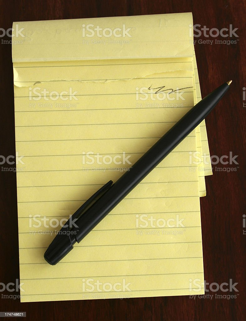 note pad and pen on desk royalty-free stock photo