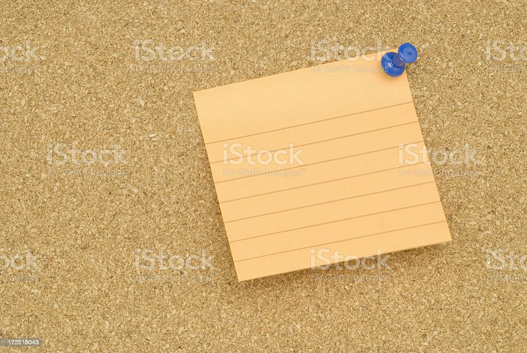 Note pad on brown bulletin board royalty-free stock photo