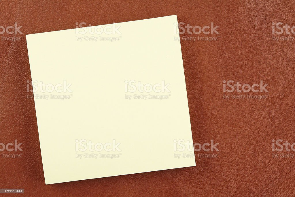 Note pad on natural brown leather royalty-free stock photo