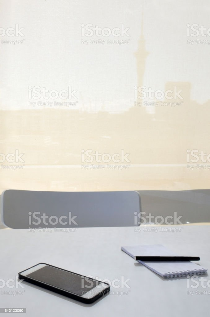 Note pad, pen and mobile phone on office desk stock photo