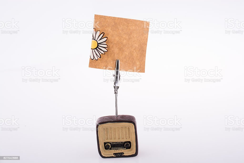 Note paper attached to an retro styled radio stock photo