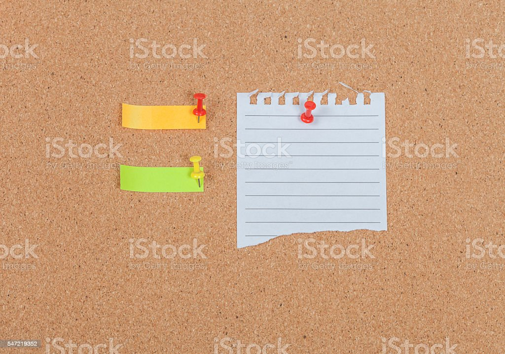 Note paper with  pin on the cork board stock photo