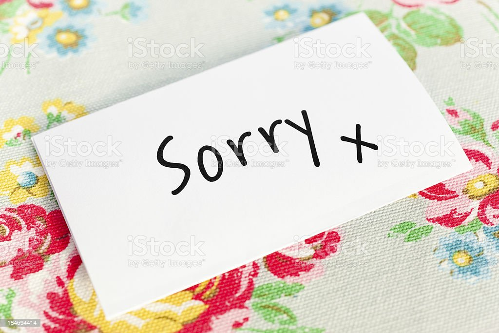 Note paper with sorry as text on table stock photo
